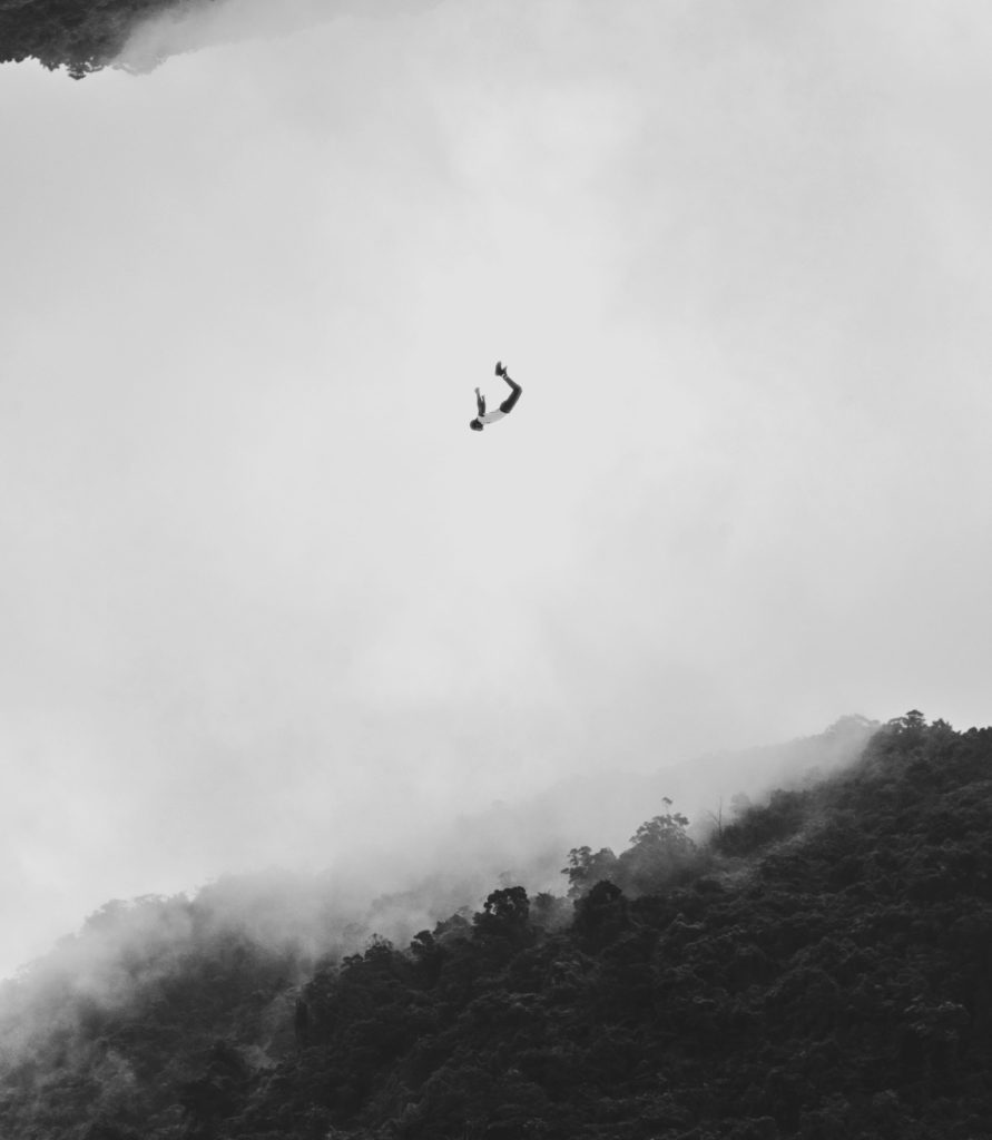 Black and white image of man falling